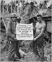 """The U.S. Marines salute the U.S. Coast Guard after the fury of battle had subsided and the Japanese on Guam had been defeated. """"They (the Coast Guard) Put Us Here and We Intend to Stay"""" is the way the Marines felt about it., ca. 08/1944. (The U.S. National Archives) Tags: usmc japanese war wwii worldwarii marines marinecorps guam 1944 veteransday secondworldwar worldwartwo amtrac uscg unitedstatesmarinecorps usmarines pacifictheatre uscoastguard lvt usmarinecorps unitedstatesmarines august1944 usnationalarchives nara:arcid=513182 081944"""