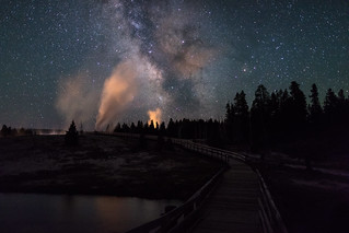 Milky Way and Castle Geyser viewed from the boardwalk over the Firehole River
