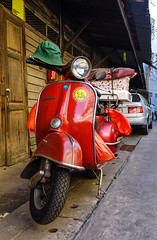 Scooter parked at an urban street in old townhouse (phuong.sg@gmail.com) Tags: automotive background building carrier city colorful commute freedom grunge iconic italian metal modern moped motorscooter motorbike motorcycle old painted parked practical red ride riding road roadside scooter shabby sidewalk sideways steel street town townhouse transport transportation travel trendy urban vehicle vespa vibrant vivid wall wheels window