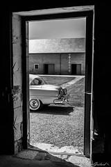 American way of life (christian.grelard) Tags: car automobile american americanwayoflife chrysler frame door farm bw blackandwhite noiretblanc nb monochrome canon eos 700d