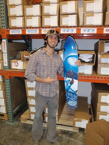 Jay with one of his longboard skateboard models at the warehouse