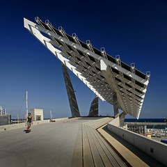 Spain - Barcelona - Solar Array - sq (Darrell Godliman) Tags: barcelona travel copyright espaa building travelling green tourism architecture buildings solar spain nikon europe barca skateboarding squares bcn eu solarpanel catalonia alternativeenergy squareformat skateboard skater catalunya d200 sq europeanunion allrightsreserved skateboarder solarpanels sustainability regeneration photovoltaic solarpower redevelopment solarenergy architecturalphotography sustainabledesign travelphotography eixample europeseunie bsquare photovoltaics solararray unineuropea nikond200 instantfave torreslapena unioneuropenne portforum omot  travelphotographer forumesplanade flickrelite dgphotos darrellgodliman wwwdgphotoscouk architecturalphotographer photovoltaicpanels dgodliman pergolafotovoltaica esplanadaforum spainbarcelonasolararraysq 2009dgodliman