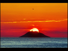 ...natural geometries... (zio.paperino) Tags: light sunset red sea vacation sky italy sun mer holiday color bird sol beach nature yellow clouds landscape geotagged island atardecer volcano soleil mar nikon europe italia tramonto nuvol