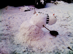 Limbo (Lisa Katherine Lenore Brown) Tags: snow garden snowman stripes bent beret limbo bending