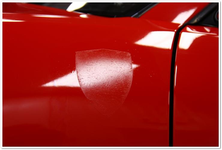 Ferrari 355 GTS debadged adhesive residue