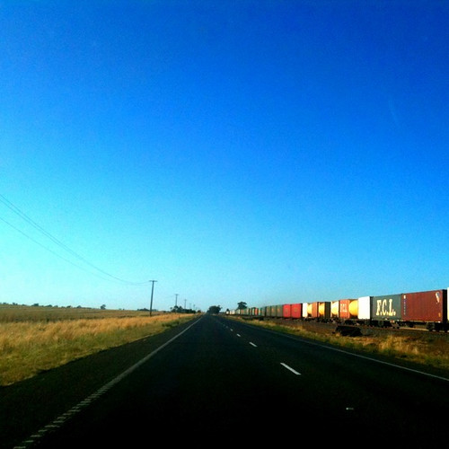 A road, a train, a landscape and a big blue sky