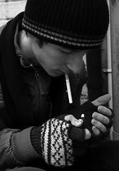 Addiction (2) (TicklePhotography) Tags: lighting portrait white black cold male college composition digital canon lens eos kent natural retrato location smoking flame portraiture half addicted 1855mm lighter tight cigarettes length addiction tobacco addict reflector dartford cigarro cigarrillo fumando retratismo 400d