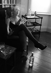 Reading Sweet Danger (Verity Rosamond) Tags: selfportrait me myself reading afternoon smoke lounge drinking gritty smoking blonde heels blinds novel lounging fags smoky ashtray gin shadowing filmnoir stillettos leatherarmchair drinkstrolley sweetdanger booklined ginandlemon greenpenguinbook