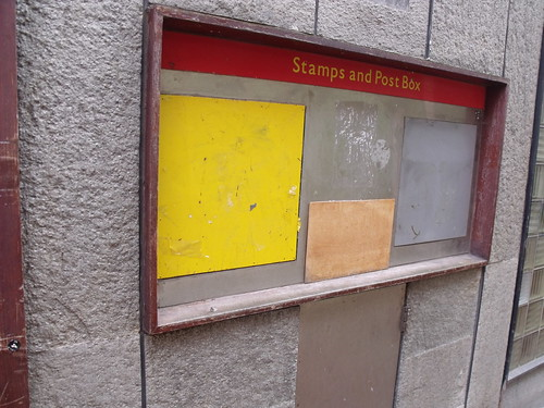 Signs of a former Post Office in Union Passage - stamps and post box