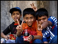 mischievous eyes.. (On The Abbey Road) Tags: childhood kids v cocacola mumbai playful mws vasaifort