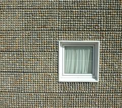 Eastbourne, precast pebble panels (streetr's_flickr) Tags: window square coast seaside nikond70 stones pebbles rows eastbourne casting walling