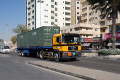 TRUCKING IN DUBAI (Claude  BARUTEL) Tags: man dubai united transport emirates arab sharjah trucking