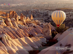 Ballooning over Cappadocia Valleys at dawn - Kapadokya (Cappadocia), Turkey (purplicious*) Tags: world morning travel light shadow chimney hot heritage history nature rock sunrise turkey landscape volcano site scenery rocks tour natural air turkiye balloon rocky surreal scene unesco worldheritagesite formation explore fairy valley shade historical civilization dreamy geography shape magical region volcanic tufa chimneys cappadocia formations dreamscape anatolia greme kayseri sceneries nigde kapadokya aksaray rgp nevsehir capadocia explored kirsehir ballooningtrip hopeitdoesntlookashidiouslysaturatedandsharpenedasitdoesonmyscreen zeynepthomas allrightsreservedzeynepthomas