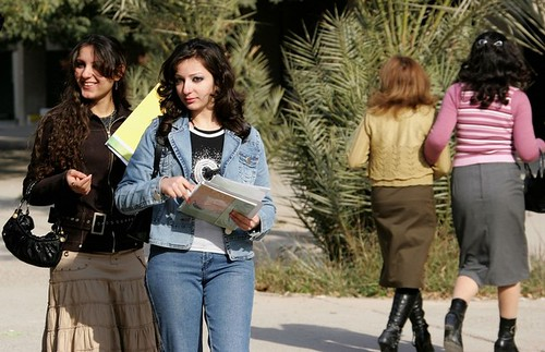 Iraqi women wearing jeans, tops and leather shoes at Baghdad University