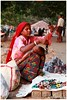 Rigours of Life.... of a Mother.. (Naseer Ommer) Tags: india canon women kerala seller fortcochin dailybread naseerommer canoneos5dmarkii discoverplanet dpintl streetphortography