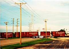 Former Milwaukee Road boxcars in transit on a northbound Indiana Harbor Belt Railroad train.  Bridgeview Illinois. September 1989.