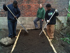 YouthBuild finishing a raised bed