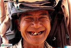 Smiling old Asian man (Asian Images) Tags: poverty old travel portrait people bali man men smile smiling laughing portraits tooth indonesia asian happy workers funny asia asians market expression character teeth joy poor humor working smiles expressions happiness humour dental gums laugh tropical expressive worker aged sell relaxed ethnic retired selling wrinkles dreamland toothless seller tropics indonesian hawker hawkers kuta legian denpasar sellers pensioners balinese seminyak pensioner dentures indonesians