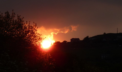 a  picture of the sun setting over Scapegoat Hill