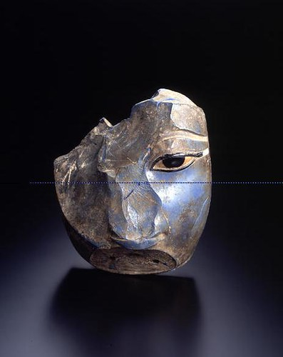 A Highly Important Egyptian New Kingdom Fragmentary Cast, Cut, and Polished Glass Head of a Pharaoh, Possibly Amenhotep III, with Black Glass and Alabaster Inlay, Of the Highest Importance for the Stu