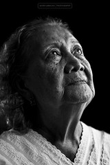 the eyes of faith (alvin lamucho ©) Tags: old grandma light portrait blackandwhite bw face lines canon 50mm eyes dress grandmother lace faith philippines lola monotone highlights age expressive emotional wrinkles nueva nanay ecija 500d 90yearsold sanjosecity t1i alvinlamucho theeyesoffaith