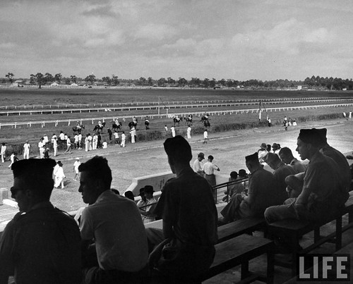 SAIGON March 1949 - Locals enjoying the horse races on a Sunday afternoon, in French Indo China.