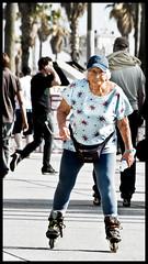 Roller Granny (Bosquet) Tags: california street old portrait people woman sun sunlight motion streets beach senior girl hat sunshine lady speed person la losangeles movement nikon grandmother walk candid character skating gray blues desaturation roller boardwalk venicebeach nik rollerblading southerncalifornia granny 80 tone