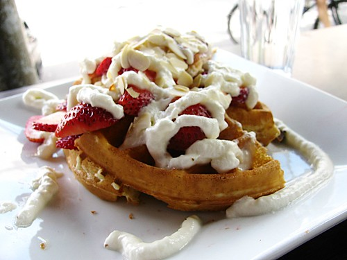 Waffles with Strawberries, Whipped Cream and Roasted Almonds @ Café Universel