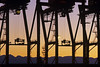 Port of Seattle at sunset with large cranes silhouetted Seattle waterfront Seattle Washington State USA (Jim Corwin's PhotoStream) Tags: load loading industry commercial silhouetted silhouettes shipping shipped water exports imports trade global business transportation photography outdoors sunset horizontal pacificnorthwest pugetsound seaport cargoship eastpacificrim evening freightterminal northamerican portofseattle bay marineterminal nobody waterfront urban urbanscene industrial ship cranes backlit crane row industrialequipment port unload unloading seattle