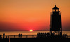 Sunset Silhouettes (T P Mann Photography) Tags: summer sun sunset sundown glow golden orange sky light lighthouse pier people silhouette silhouettes night show glorious color shadows sea seascape water lake michigan charlevoix tourist public nature rural warm evening dusk boats beach shore popular site anawesomeshot fence friday canonflickraward