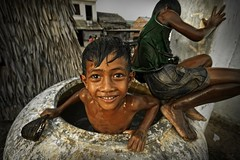 Andong Village, Phnom Penh - Bathing in Dirty Comtaminated Water (Mio Cade) Tags: school boy house water girl children student garbage education cambodia village staff electricity volunteer build injustice slum phnom ngo scavenger penh latrine andong evict earthasia sombokchap