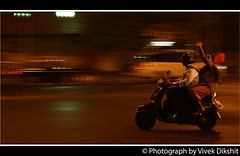 Just tried Panning Shot ;-) (Vivek Dikshit) Tags: road india motion night speed 50mm lights couple baloon scooter maharashtra pan mumbai panning rider marinedrive canon1000d vivekdikshit