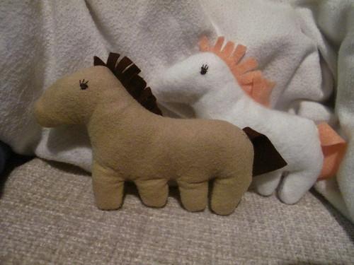 A pair of felt horses