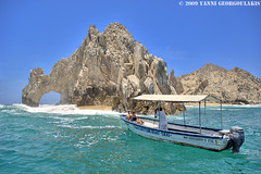 Cabo Arch Taxi boat (Yankis) Tags: sky water rock mexico cabo nikon san arch taxi lucas formation end land lands