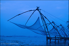 Chinese fishing nets (Arvind ( www.arvindbalaraman.com )) Tags: ocean travel blue sunset sea sky people india lake seascape color colour reflection net tourism beach nature wet water beauty crimson silhouette sunrise river landscape evening coast boat fishing fisherman holidays colorful fort dusk indian horizon chinese dramatic kerala tourist calm coastal tropical coastline kochi kochin blissful