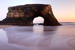 Natural Bridges State Beach - Santa Cruz, CA (Sudheendra Kadri) Tags: ocean california longexposure sunset sea sky santacruz color beach nature water landscape flow surf arch smooth lowtide sudhi naturalbridgesstatebeach naturalwindow sudheendrakadri