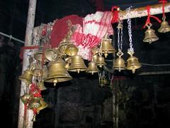 temple bells (Linda DV) Tags: travel people india bells canon geotagged temple prayer shiva assam 2008 siva sevensisters puja chimes sivasagar sibsagar 7sisters northeastindia powershots5is lindadevolder sivadol