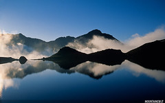 Estany Blau de Siguer (MOUNTAINCULT) Tags: blue sunset sky cloud mist mountain lake black france reflection nature water beautiful fog azul clouds trekking landscape europa europe magic lakes deep