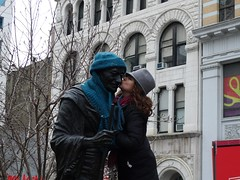 lovin on gandhi (tippy tippy) Tags: nyc flowers winter newyork statue knitting knit freezing gift gandhi ghandi gothamist scarves rosepetals unionsquare warming 2010 sitar gifting january30 installationproject hatgiveaway gandhiwarmer