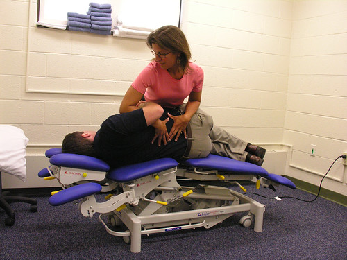 Physical Therapist Laurie Devaney demonstrates how the new mobilization table improves her ability to treat spine injury patients.