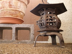 A Tad Out of Place (wadetaylor) Tags: brown lamp metal wall carpet japanese floor flowerpot lantern cinderblock