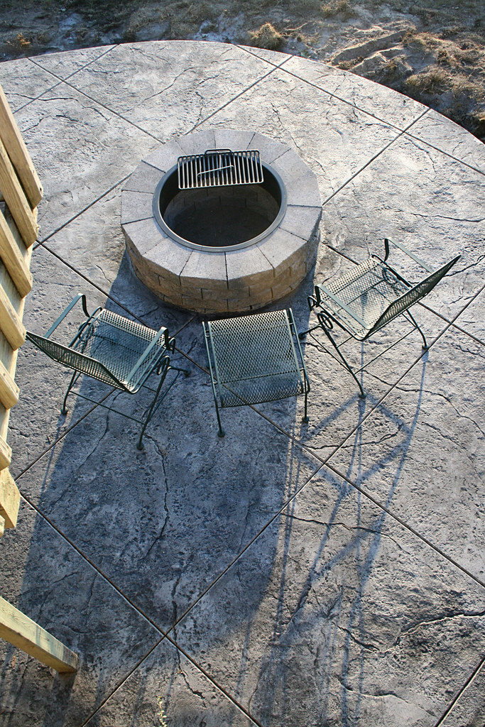 Seamless Stamped Concrete patio - natural with charcoal antiquing release agent. Firepit and patio by The Concrete Artisans, Inc