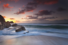 Porthcurno Sunrise (antonyspencer) Tags: uk seascape motion beach rock sunrise landscape coast rocks cornwall waves dramatic end coastline colourful lands logans porthcurno treen 5dmkii