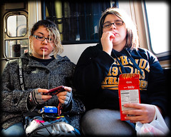 Are you the kind of friend that you would want as a friend? (TheeErin) Tags: girls two people chicago train glasses cta candy eating duo authority teenagers el transit lipring specs l pocky insignia tuff chicagoland orangeline chicagotransitauthority chicagoist