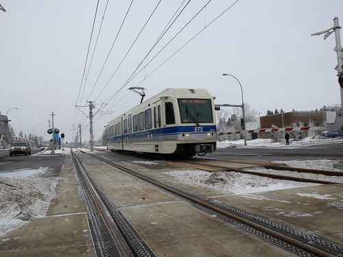 LRT on 111th Street travels the median of the roadway