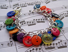 newest two-hole button explosion charm bracelet (randomcreative) Tags: silver rainbow explosion jewelry bracelet etsy multicolored charmbracelet lobsterclasp plasticbuttons jumprings randomcreative buttoncharms twoholedbuttons