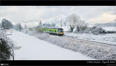 A Winter Commute (bbusschots) Tags: ireland winter panorama snow clouds train canal diesel pano rail railway railcar 1001nights maynooth hdr irishrail jol trainset topaz kildare royalcanal dmu leixlip tthdr panoramiccrop iarnrdireann flickraward pixelmator thebestofday gnneniyisi topazadjust dmu4 class29000