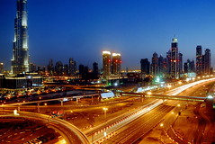 TRUCKING IN DUBAI (Claude  BARUTEL) Tags: world building night long exposure dubai united transport emirates khalifa arab sharjah trucking burj tallest the in
