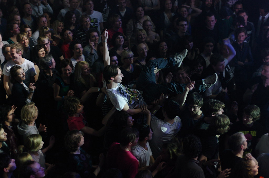 happy crowdsurfer