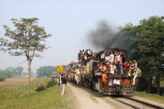 Sitamarhi train leaving Dhang (Keighley Bee) Tags: india train diesel overcrowding dhang roofriding metregauge